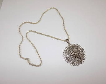 Large sterling silver filigree pendant and 20 inch necklace