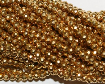 """13"""" Strand Gold Pyrite Faceted Round Beads 2mm."""