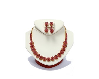 22kt gold ruby necklace and earring set with 22.35 carats in rubies