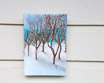 Trees in a snowy park blue sky and clouds pyrography art wall hanging, wood burned on a Pine tree wood slice, Calgary sky, for nature lovers