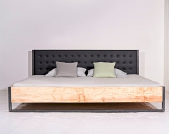 Bed made of recycled timber, steel and vegan leather