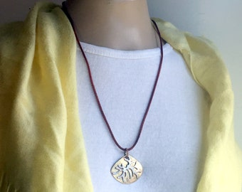 Ala Matisse brass and german silver pendant on Greek Leather cord