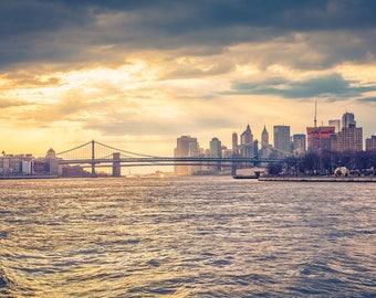 Colour photograph of Manhattan and Brooklyn Bridge at sunset
