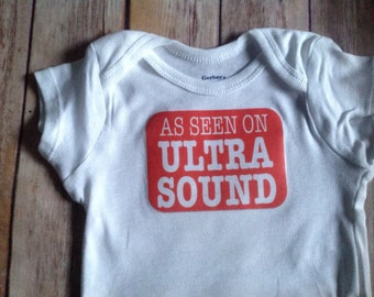 As seen on ULTRA SOUND Baby One Piece (Custom Colors/Wording)