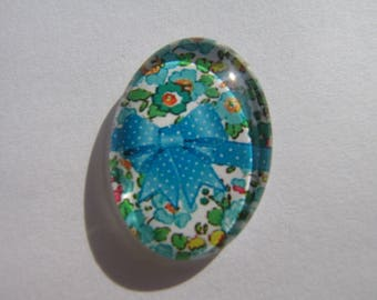 Glass cabochon oval with its liberty image floral turquoise and green with a bow