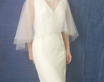 Cape clear to pale pink fine tulle wedding dress. Off white Calais lace neckline. Wedding accessory.