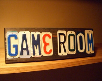Game Room sign made with recycled license plates.