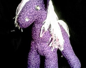 Purple floral stuffed pony