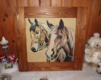 frame rustic two horses on a beige background
