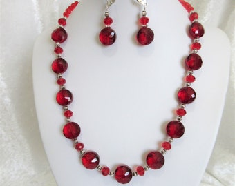 """Red crystal necklace set, 18"""" red crystal necklace, 14mm flat rounds and 6mm rondelles, earrings hang 1.25"""" from lever back closures, 5-T"""