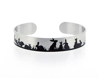 Rabbit jewellery, brushed silver cuff bracelet, metal bangle with bunnies in black. Animal lover bunny rabbit gifts. S502