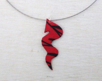 Pendant red striped fabric with black snake