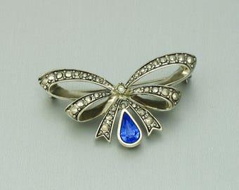 Vintage AVON Faux Marcasite Sapphire Blue Rhinestone September 'Birthstone Bow' Brooch (1994). Vintage Avon Jewelry. Avon Bow Brooch