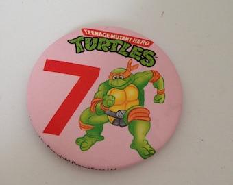 Vintage Teenage Mutant Ninja Turtles badge - age 7