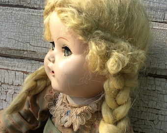 vintage doll,collectible,hard plastic head,eyes open and close,blue eyed doll,blond braids,creepy doll,doll with teeth