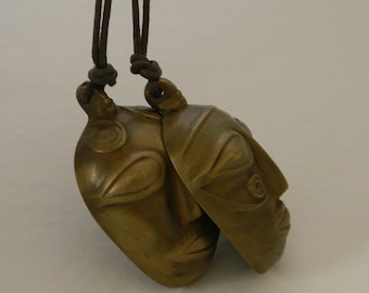 African tribal mask pendant on leather cord necklace , brass mask jewelry , African tribal jewelry , mask jewelry , tribal mask jewelry