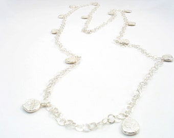 Very long silver nuggets necklace, very elegant , a must to have,   this necklace makes an enduring statement. and yet minimalist necklace.
