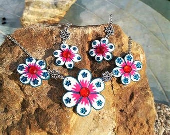 Pink and blue flowers with Rhinestones made of polymer clay ornament.