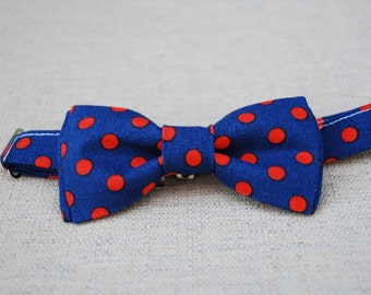 Navy and orange polka dot bow tie