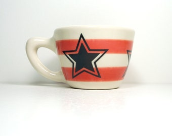12oz cup with a 5-pointed star, shown here on red-orange stripes - Made to Order / Pick Your Colour