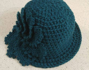 Crochet cloche hat with large flower
