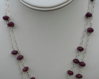 Handmade necklace made of sterling silver and natural faceted rubies.