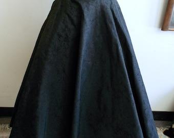 "1950's, 26"", black flocked taffeta circle skirt"