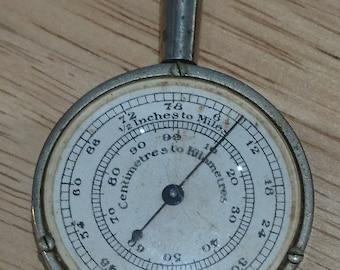 Vintage map measuring device