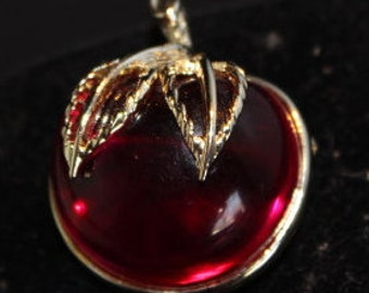 "SARAH COVENTRY - ""BURGANDY"" Clear burgandy colored apple brooch."