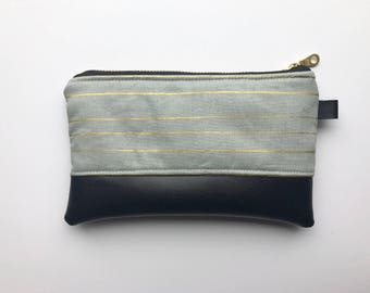 Gray and gold striped coin purse with black faux leather