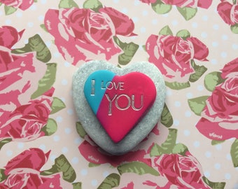 """Pink & blue clay heart inscribed """"I Love You"""" mounted on Heart Shaped Stone"""