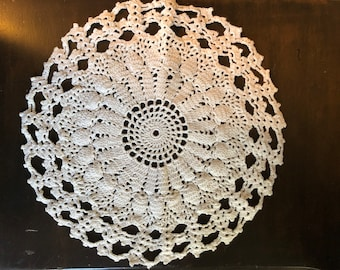 Ivory crocheted doily 11 inches in diameter