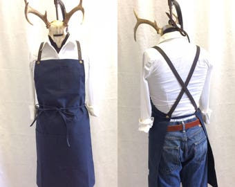 Apron with crossed back straps