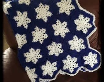 Big, cuddly, gorgeous snowflake throw afghan blanket.  Snowflakes are soft and bright white on a dark blue background. Super big 59 hexagons