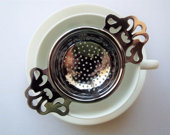 Vintage Tea Strainer. 1960s loose leaf tea infuser. Retro chrome tea strainer for sitting on a teacup. Perfect for an afternoon tea party!
