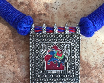 Oxidized silver tone elephant pendant with blue and red thread