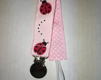 Pink ladybug pacifier holder