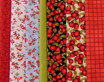 7 Christmas Fat Quarters including Winter Cardinals by Windham Fabrics