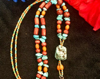 boho style necklace, turquoise stone, wood and glass orange and turquoise colored beads with leather tassel
