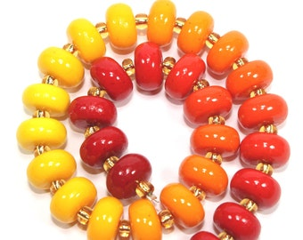 Colorful elegant Ombre beads, polymer Clay beads, unique beads in gradual transformation from shiny reds to oranges to yellows, set of 30.