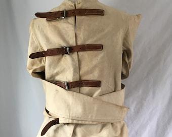 Authentic medical straight jacket from the Maine Insane Hospital AMHI