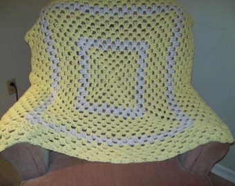 Crocheted yellow and white baby blanket/afghan/throw in granny square pattern