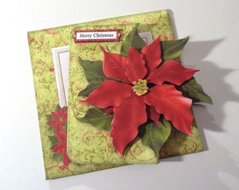 Handmade poinsettia shaped Christmas card with matching envelope.