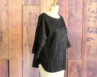 1970s blouse . black and silver blouse with boatneck . metallic disco top . womens medium large