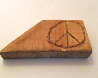 An Awkward Peace: small chiseled pine peace sign