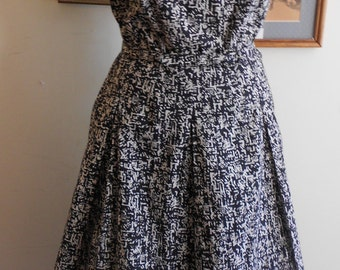 "1950's, 38"" bust, two piece black and white cotton ""sun"" dress."