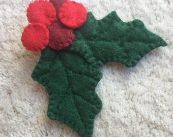 LYNN:  Felt brooch, holly leaves and berries.  Hand stitched.