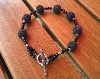 Bracelet black lava stone round beads