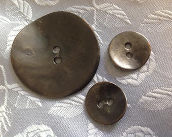Set of three buttons in metal copper silver