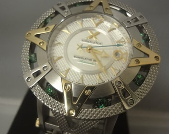 Gents large Xoskeleton 904L wrist watch, the dial being white and textured with gold tone